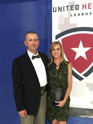 Cathy receiving an award from United Heroes League